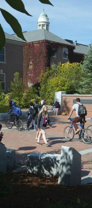 Students biking on campus.